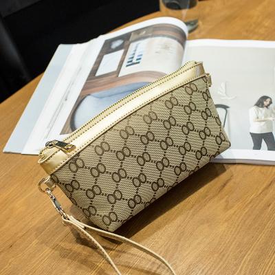 米尔 帆布手拿包女新款小手包迷你单肩包女小包包斜挎包手机零钱包