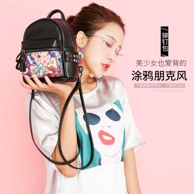 斯诺 新款涂鸦朋克风时尚柳钉女包双肩包 CP0243