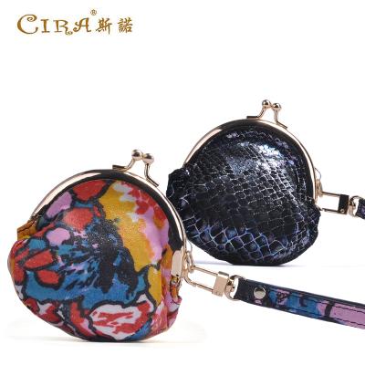 斯诺 时尚印花猪皮零钱包手拿包 C80626