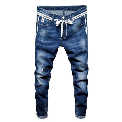 2018四季新款韩版弹力轻薄透气潮蓝水洗不规则磨烂 织带搭配元素破洞牛仔裤 8005